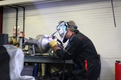 Head engineer Jon Webster welding on the new rear axle.