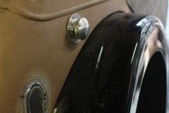 Newly positioned fuel filler cap for the custom-built fuel tank.
